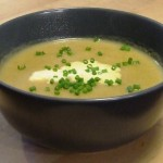 A Bowl of Allium and Root Veg Soup with a drizzle of cream and some fresh chives